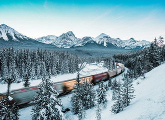 Morant's Curve with train in winter, Banff National Park, AB, Canada