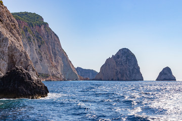 Beautiful rock formations sticking out of the shimmering deep blue sea around the island, Zakynthos, Greece