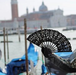 fan in the hand of the woman in Venice in Italy