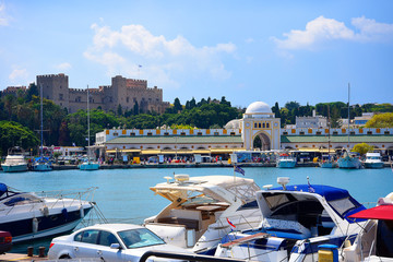 The windmills,fort of St Nikolas,Church of the Assumption and the Governors palace are on Rhodes Mandraki Harbour