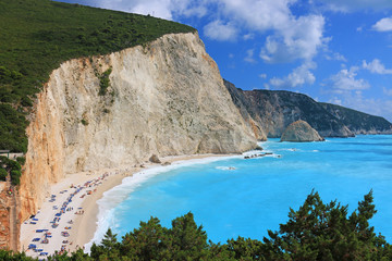 Porto Katsiki beach on the Ionian island of Lefkada, Greece. People sunbathe and enjoy on vacation. The beach is famed for its landscape and clear blue sea