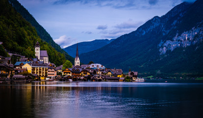 Amazing night scenery of austrian town Hallstatt at the lake and high mountains