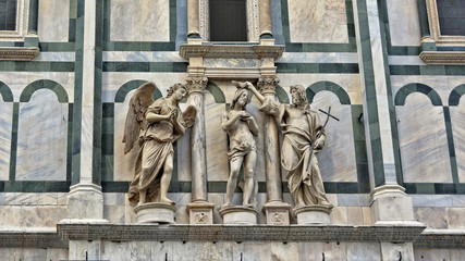 Baptizing. Medieval art. Architectural details of the Baptistery of Saint John, which is one of the oldest buildings in Florence. Italian architecture. Italy, Florence