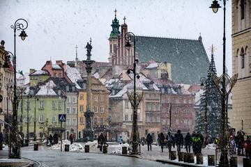 Warsaw old town winter scene under snowfall