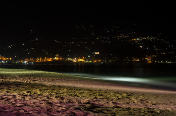Night lights mountain village near the beach of Heraklion Bay in Greece