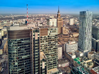 WARSAW, POLAND - FEBRUARY 10, 2019: Beautiful panoramic aerial drone view to panorama cityscape of Warsaw modern City, PKiN and