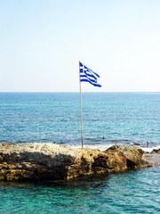 Greek flag on a small rocky island