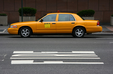 Parked yellow taxi, side view, Manhattan, New York