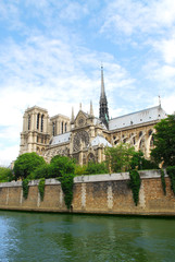Cathedral of Notre Dame de Paris - side view with rose window.