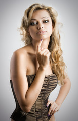 Gorgeous blond woman on grey background