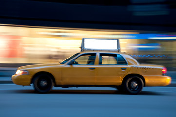 Taxi at night, with copyspace available.