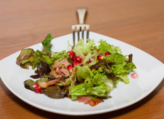 Warm salad with bacon and pomegranate