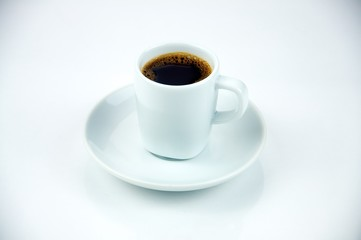 Classic Espresso in a white cup shot on a white background.