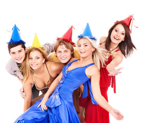 Group of young people in party hat. Isolated.