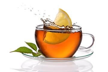 Cup of tea with lemon and splash