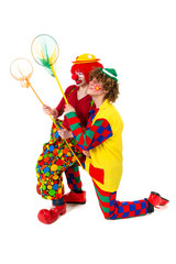 Couple funny clowns with fishing nets
