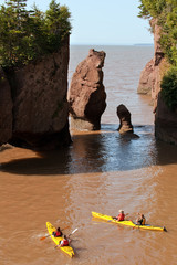 Kayaking at famous Hopewell rocks at high tide