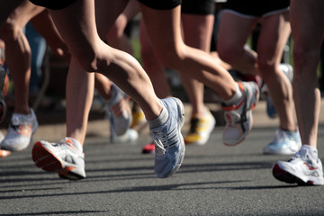People running in city marathon..