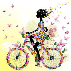 Girl on a bicycle in a romantic