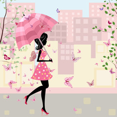 beautiful girl with an umbrella in the city