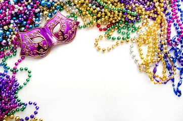 Mask and mardi gras beads
