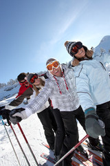 Two couples skiing together