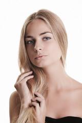 Blond beauty on white