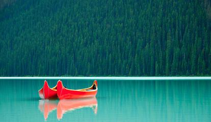 Canoes floating peacufully on Lake Louise near Banff.
