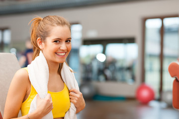 Woman smiling in a fitness club