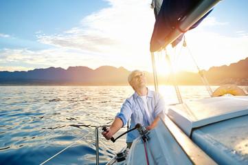 sunrise sailing boat