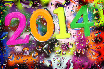 2014 year on abstract colorful drops background