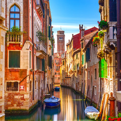 Venice cityscape, water canal, campanile church and traditional