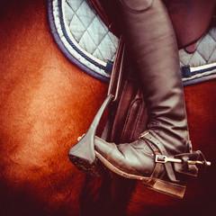 jockey riding boot, horses saddle and stirrup