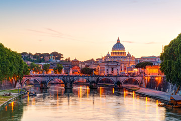 Rome at night, Italy. View of St Peter's basilica in Vatican, panorama of Roma city at sunset.