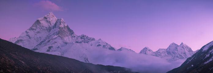 Ama Dablam peak and purple sunset in Himalayas