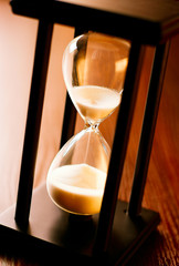 Wooden hourglass with running sand