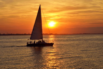 sailing boat in the sea at sunset