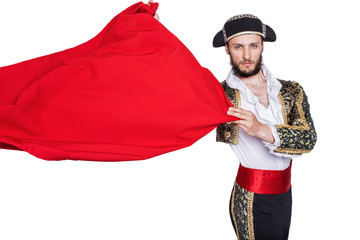 Matador throwing a red cape