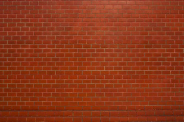Red brick wall suitable for a background.