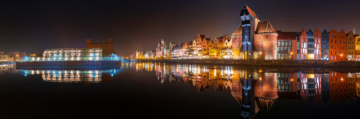 Panorama of Gdansk old town with reflection in Motlawa river