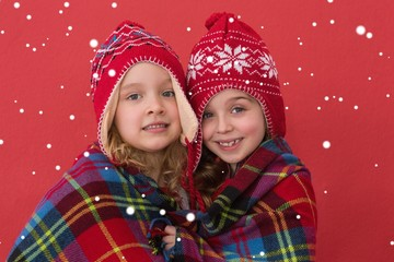 Composite image of festive little girls smiling at camera