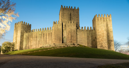 castle of guimaraes in portugal at night with lamps