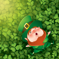Leprechuan lying on clover leaves background.