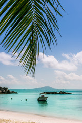 Boat on Tropical beach at Curieuse island Seychelles