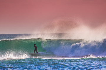 Surfer on Blue Ocean Wave in Bali