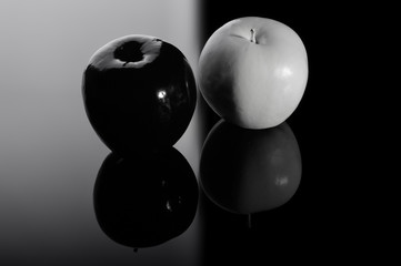 Black apple and white apple.