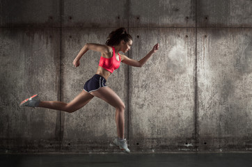 Side view of running woman