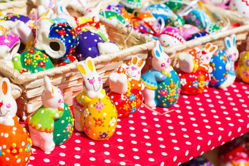 Colorful Easter Bunny figurines at the market