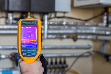 Thermal imaging inspection of heat system with tubes at house