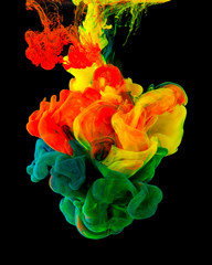 Colored ink isolated on black background